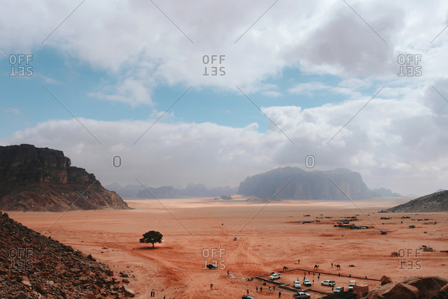 Wadi Rum on background of camp with cars in scenic view
