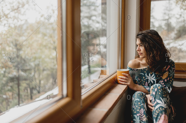 Close up caucasian sensual just woke up woman portrait with cup of hot beverage.