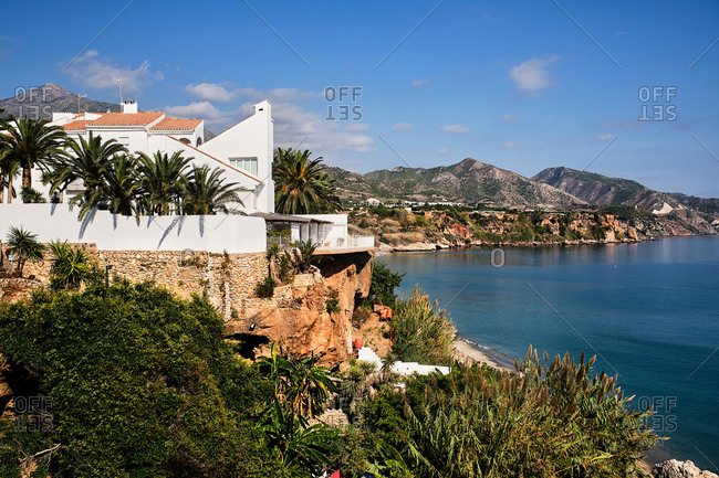 Magnificent scenery of coastal city and calm sea under blue sky in summer in Spain