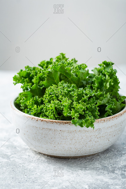 Close up of kale in bowl on light surface
