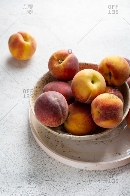 Close up of bowl with peaches