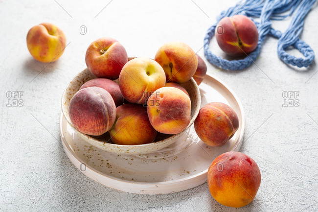 Close up of peaches on light surface
