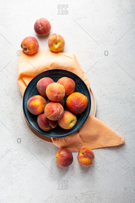 Overhead view of peaches on light surface