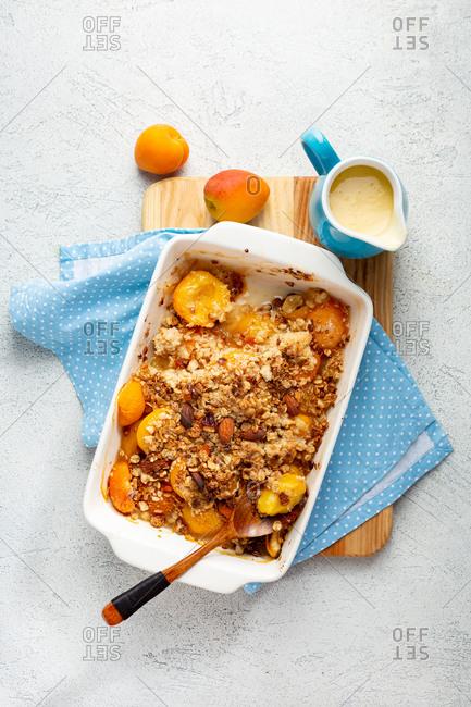 Overhead view of peach granola crumble breakfast