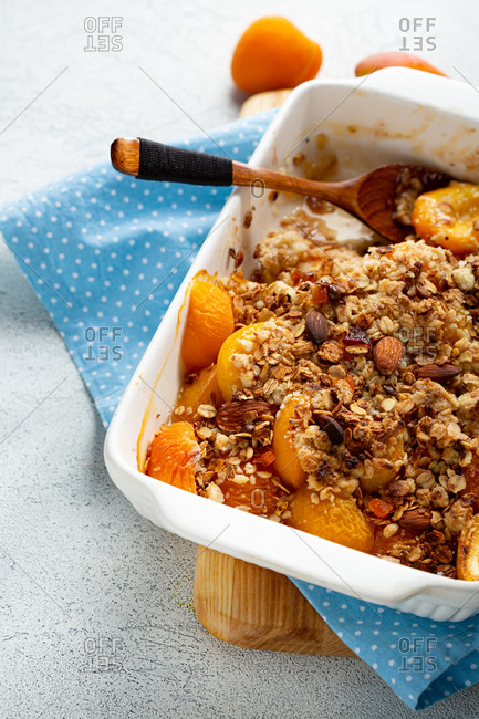 Close up of peach granola crumble with custard and almond