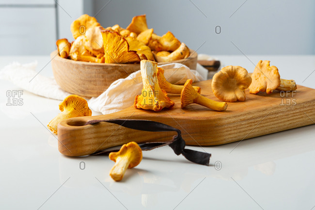 Close up of forest mushrooms on cutting board on domestic kitchen