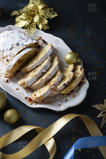 Sliced Christmas cake and decorations