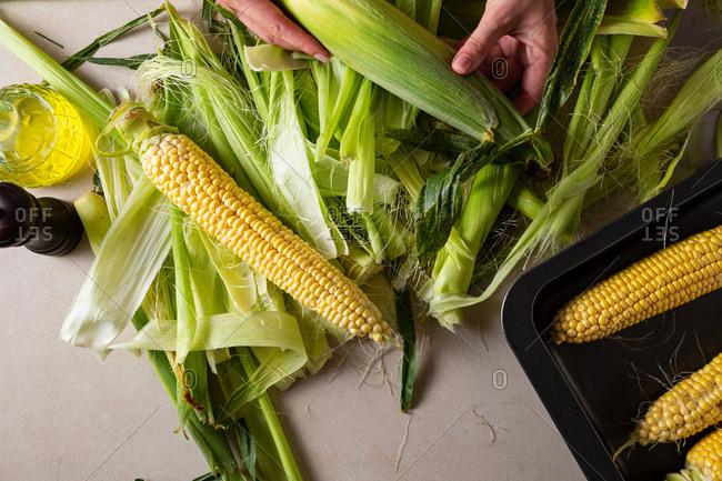 Overhead of peeling corn on the cob