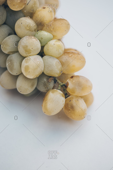 A bunch of white grapes on a white background close up