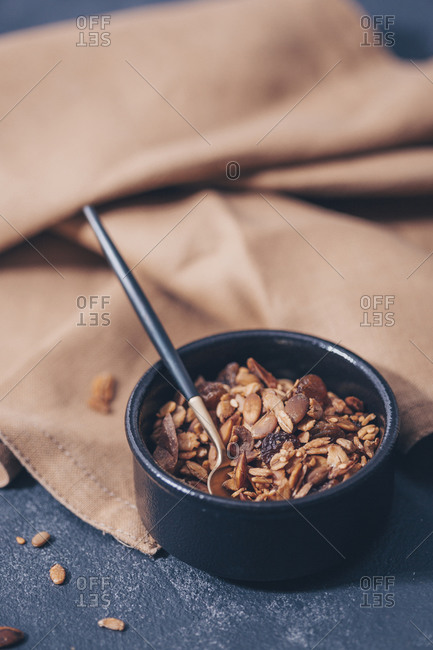 Homemade granola in black bowl on table