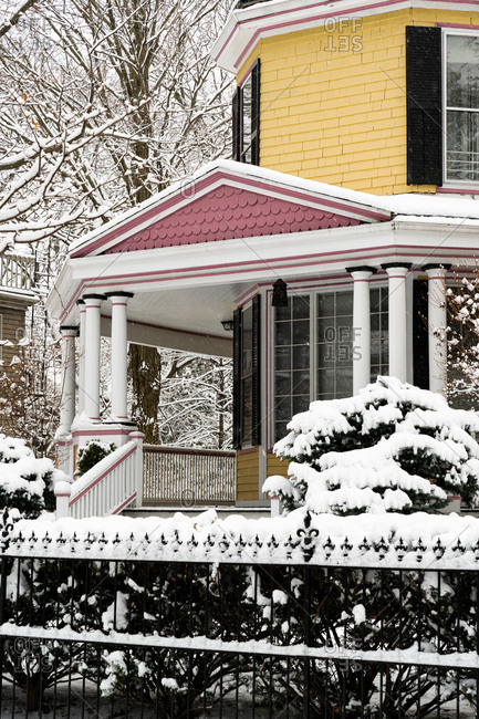Colorful old home covered in fresh snowfall in winter