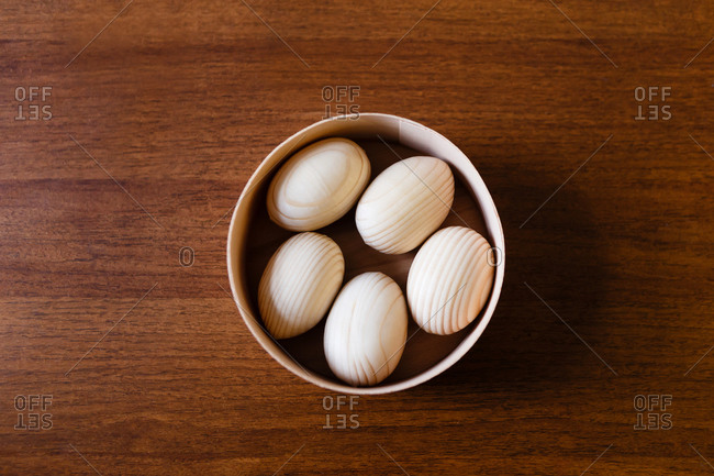 Wooden Easter eggs in a wooden box on table