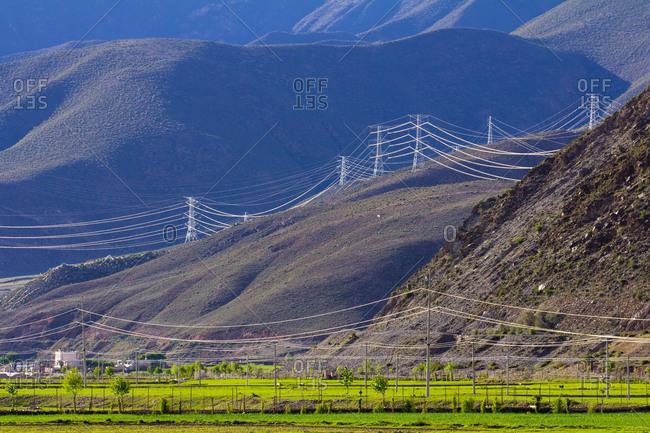 Power lines running through mountains in China's Tibet Autonomous Region