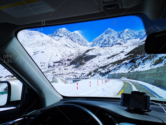 Snow seen through car windshield on the highway in Western Sichuan, China