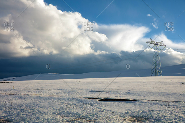 Electrical lines above snowy landscape in the Tanggula Mountains in the Tibet Autonomous Region