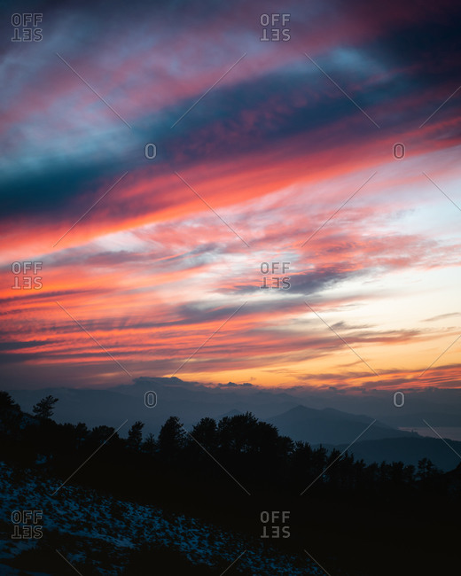 Colorful storm clouds during a beautiful sunset in snowy Jaizkibel, Basque Country