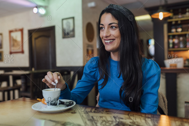 Attractive young woman with coffee in restaurant