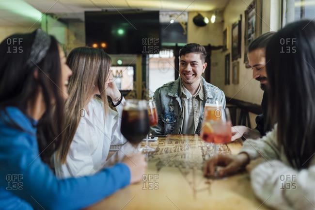 Happy friends having drinks in restaurant