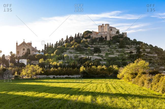 Spain- Mallorca- Arta- Grassy field in front of Santuari de Sant Salvador