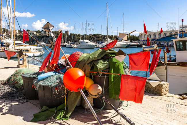 Spain- Mallorca- Porto Cristo- Buoys- flags and fishing nets lying in harbor