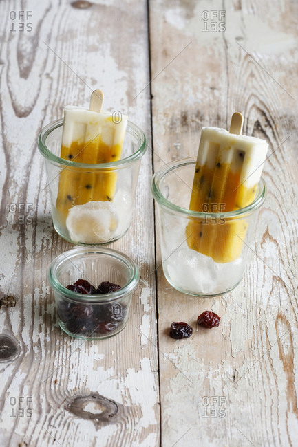 Homemade popsicles with mango and passion fruit