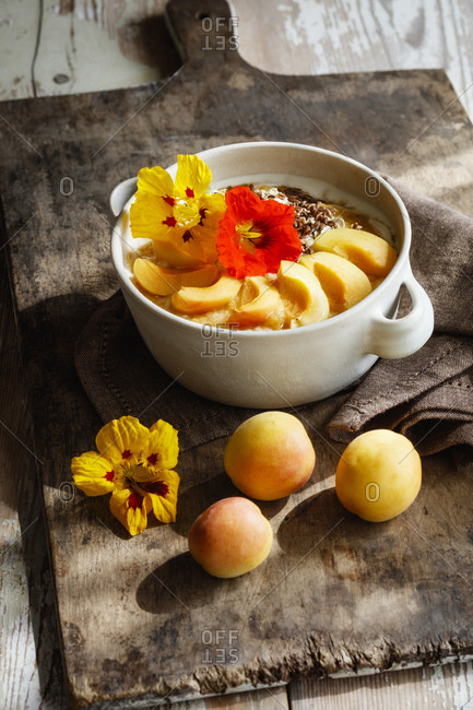 Bowl of cottage cheese with apricots- flax seeds and decorative nasturtiums