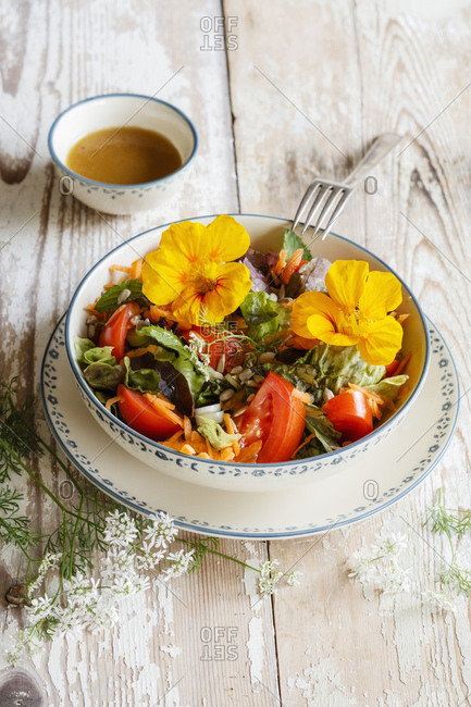 Bowl of vegetarian salad with edible flowers