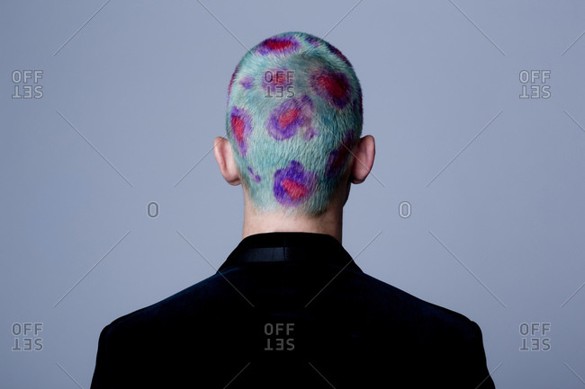 Young man with dyed shot hair studio