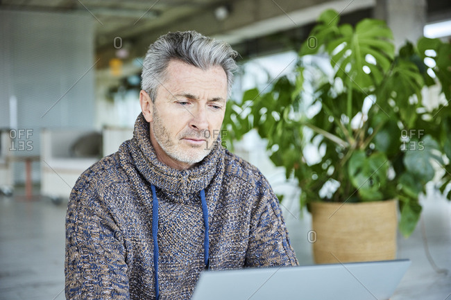 Man using digital tablet while sitting at office