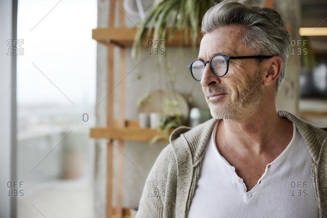 Mature man wearing eyeglasses looking away