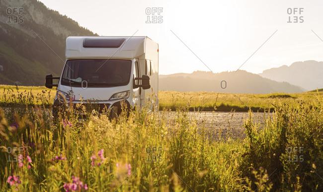 Camper van parked at Col des Aravis- Haute-Savoie on sunny day- France