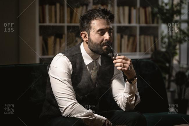 Portrait of bearded man smoking pipe