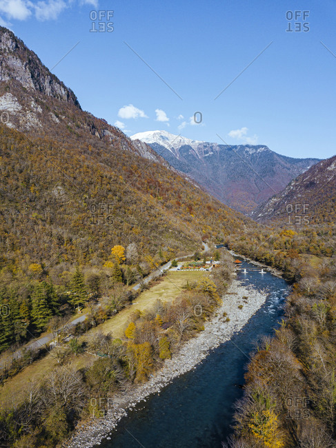 Aerial view of Bzyb River flowing through forested valley in Caucasus Mountains
