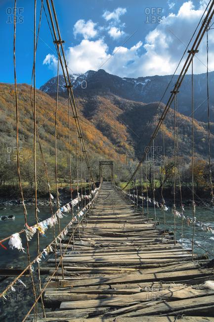 Old suspension bridge stretching over Lupshara River