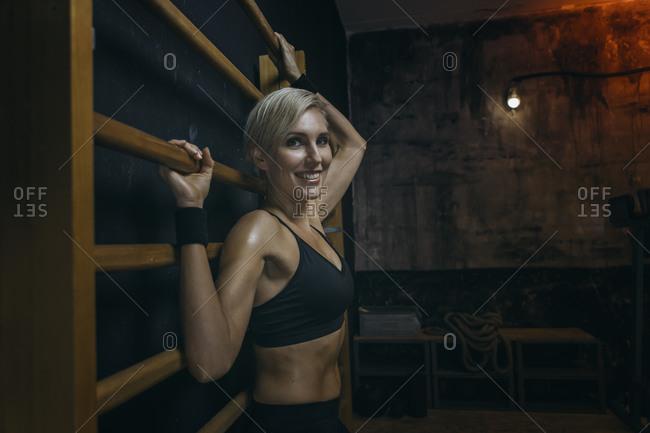 Blond sportswoman at sport bars