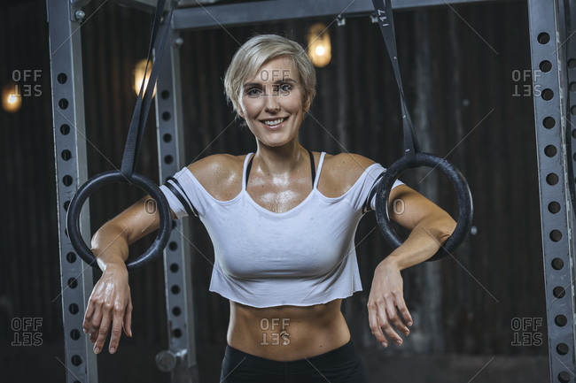 Portrait of blond sportswoman wearing white t-shirt in gym