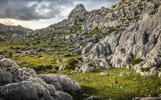 Woman hiking in rocky landscape