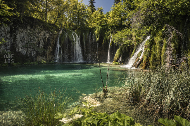 Waterfalls and turquoise lake in outdoor park