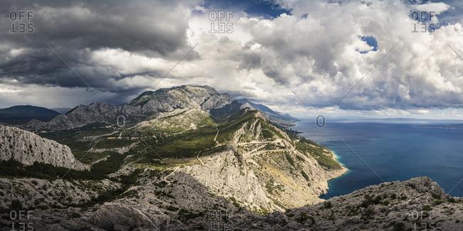 Mountains and sea coast setting outdoors