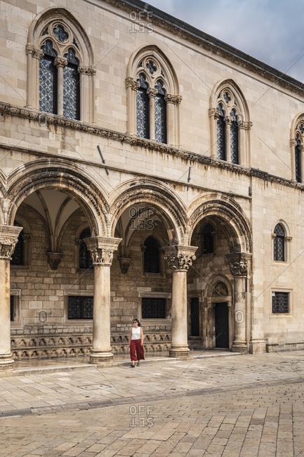 Croatia- Dubrovnik- Woman at Sponza Palace