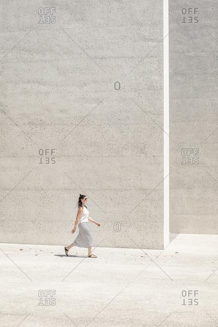 Slovenia- Ljubljana- Monument to the Victims of All Wars (Spomenik rtvam vseh vojn)- Woman walking near concrete wall