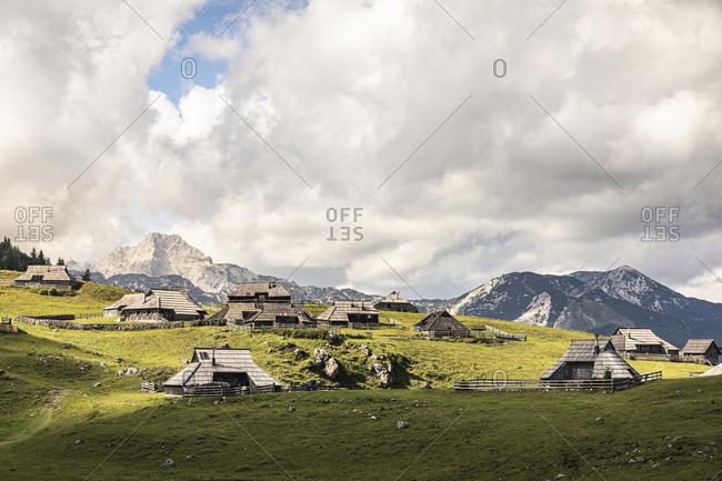 Alpine settlement with shepherds houses