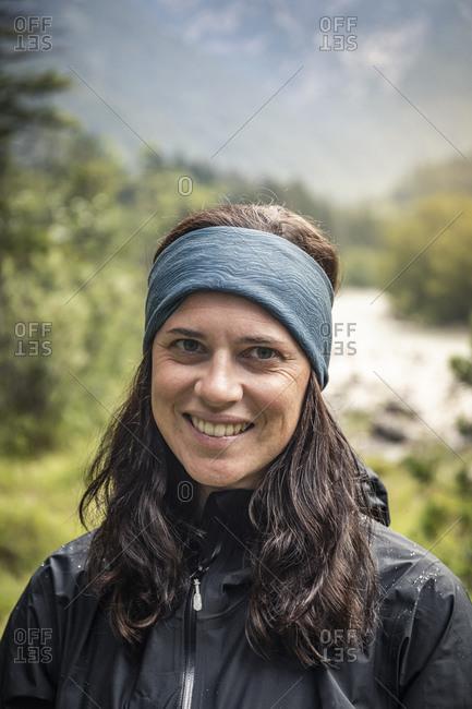 Portrait of smiling woman in landscape
