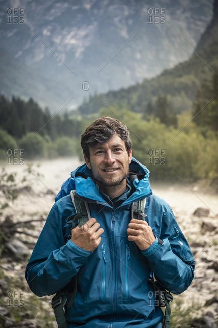 Portrait of smiling man in landscape