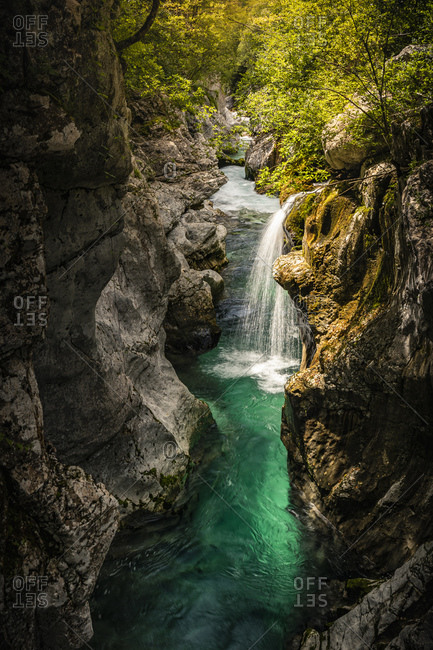 Turquoise river and waterfall overview