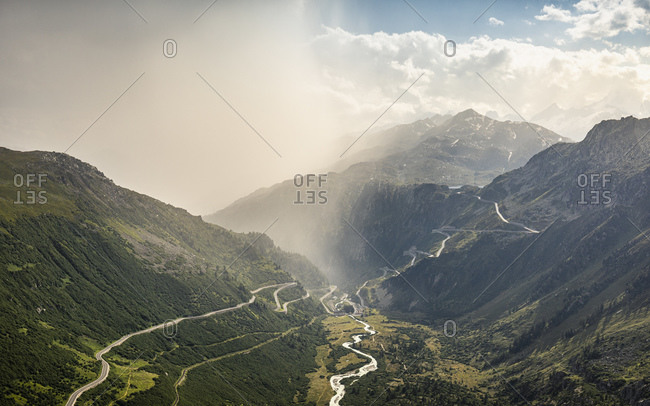 Storm clouds over mountain and valley with river