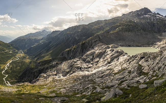 Glacier tongue lake and river in mountain landscape