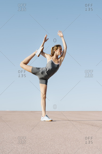 Female sportsperson practicing dancer pose on a sunny day