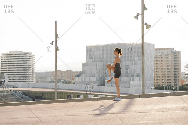 Female sportsperson doing warm up exercise on a sunny day