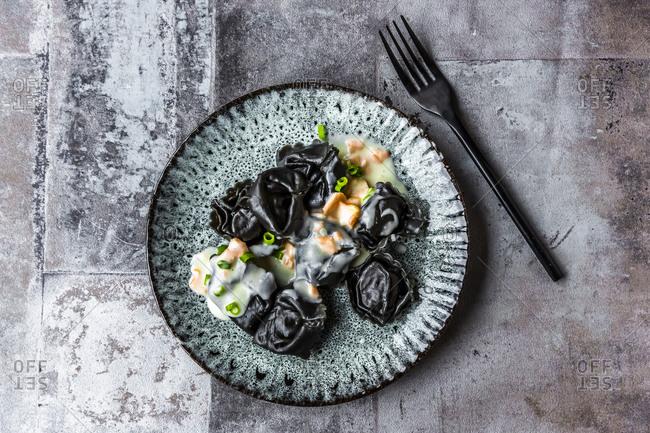 Black tortellini with salmon cream sauce